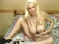 Milf with big tits solo masturbates